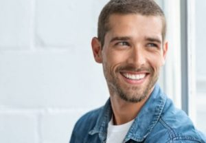 man with a winning smiling after teeth whitening